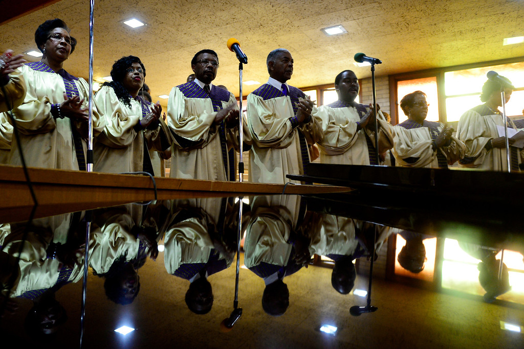 . The Macedonia Baptist choir performs during the service on November 24, 2013. Pastor Victor-LaMonte Lane was installed as the new pastor of Denver\'s Macedonia Baptist church on December 6, 2013. (Photo by AAron Ontiveroz/The Denver Post)
