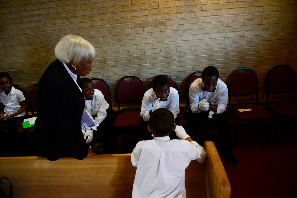 . Ta\'yon Burton (center), 12, Darerl Burton (right), 15, and Jeremiah Davis (facing away) chat during Sunday\'s service at Macedonia Baptist church in Denver on November 24, 2013. (Photo by AAron Ontiveroz/The Denver Post)