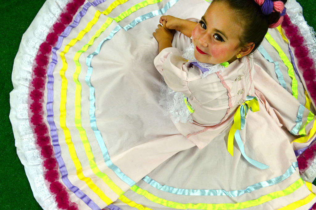. Norma Dominguez, 5, right, and other dancers with Folklorico Dance rest after their performance at the Denver County Fair at the National Western Complex in Denver, CO on August 3rd, 2014. This was the last day of the fair which included dancing, singing, dog agility courses, freak shows, and pie eating contests. (Photo by Helen H. Richardson/The Denver Post)