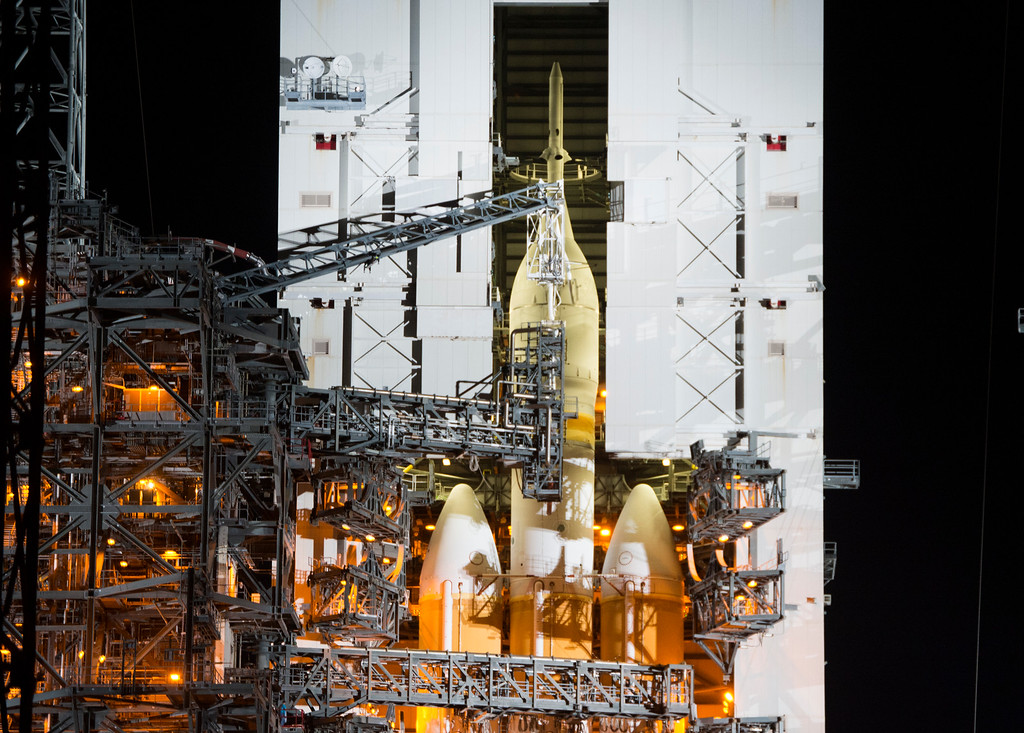 . The spacecraft Orion begins to emerge from the Mobile Service Tower as the tower rolls away Wednesday, December 3, 2014 at Space Launch Complex 37 at the Kennedy Space Center in Cape Canaveral, Florida. Orion fitted with a United Launch Alliance Delta IV Heavy rocket prepares to travel into space on the first test flight of the Orion missions which hope to some day place a man on Mars.  (Photo By Brent Lewis/The Denver Post)