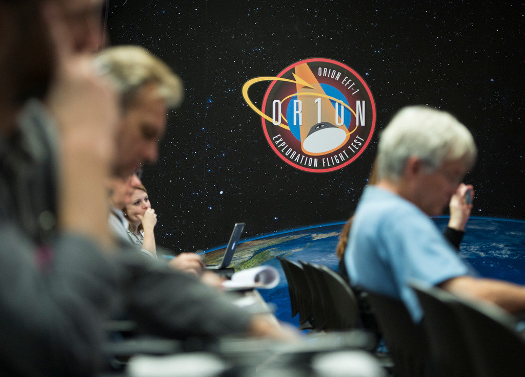 ". CAPE CANAVERAL, FL - December 2: Journalists from around the world listen take notes during NASA news briefing about the ""Journey To Mars\"" on  Tuesday, December 2, 2014 at the Kennedy Space Center in Cape Canaveral, Florida. The press conference was the first of many leading up to the launch of the spacecraft Orion which is the first of many launches that NASA hopes will lead to man stepping on Mars and asteroids. (Photo By Brent Lewis/The Denver Post)"