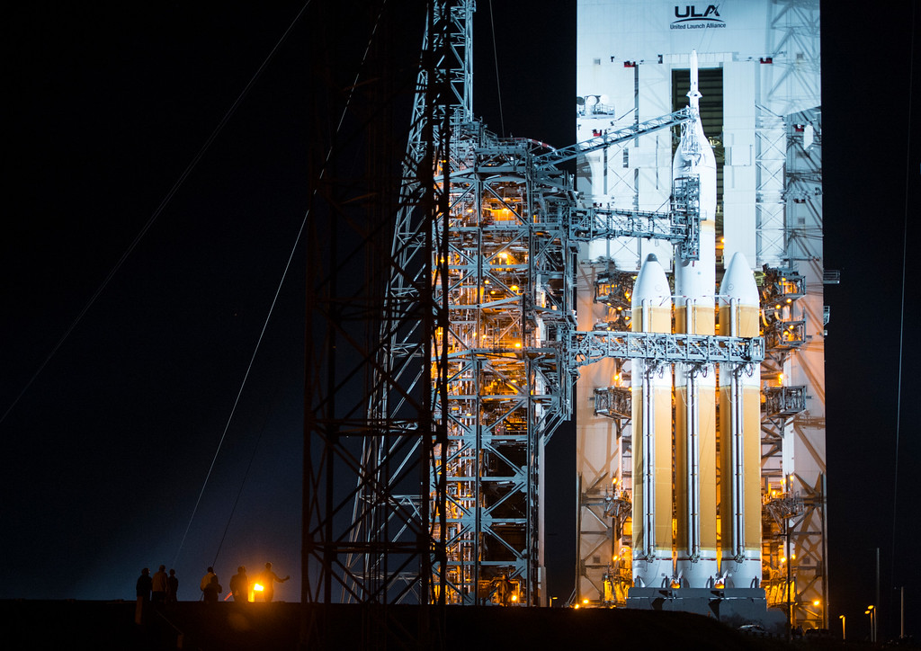 . People begin to walk up to the base of the Orion spacecraft after it is fully out of the Mobile Service Tower on Wednesday, December 3, 2014 at Space Launch Complex 37 at the Kennedy Space Center in Cape Canaveral, Florida. Orion fitted with a United Launch Alliance Delta IV Heavy rocket prepares to travel into space on the first test flight of the Orion missions which hope to some day place a man on Mars.  (Photo By Brent Lewis/The Denver Post)