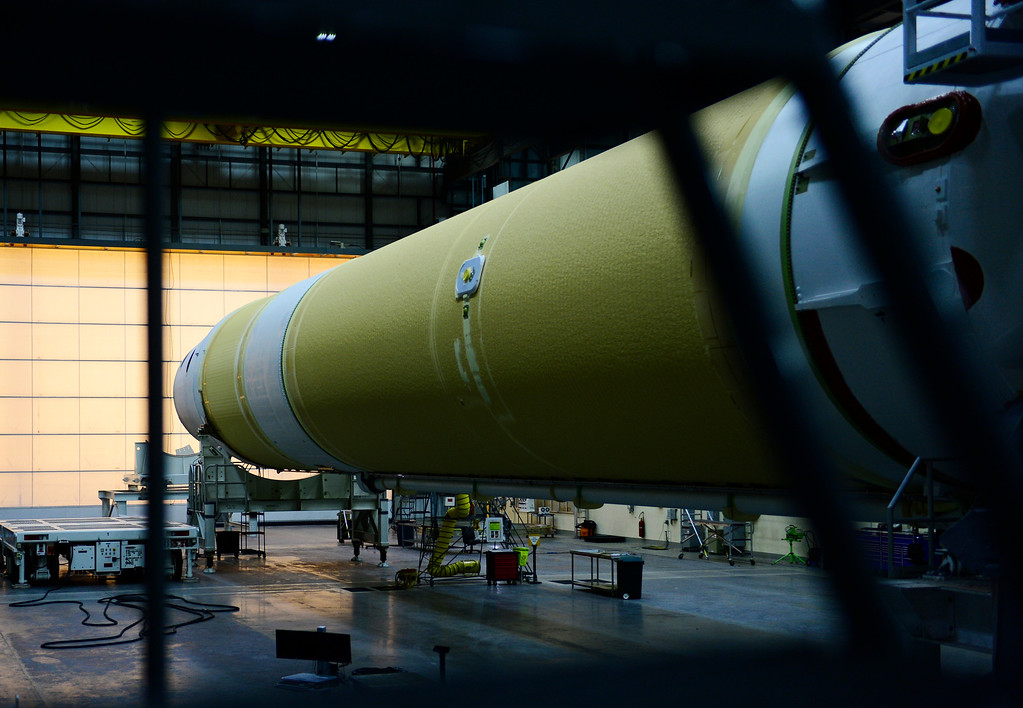 . CAPE CANAVERAL, FL - December 1: A Delta IV booster sits in the Horizontal Integration Facility on Saturday, November 29, 2014 at United Launch Alliance launch facilities at the Cape Canaveral Air Force Station in Cape Canaveral, Florida. United Launch Alliance, which is headquartered in Centennial, is preparing the final steps before the launching of the Orion spacecraft for Exploration Flight Test-1. The mission is part of a series of missions with the hopes of being able to land humans on asteroids and Mars. (Photo By Brent Lewis/The Denver Post)