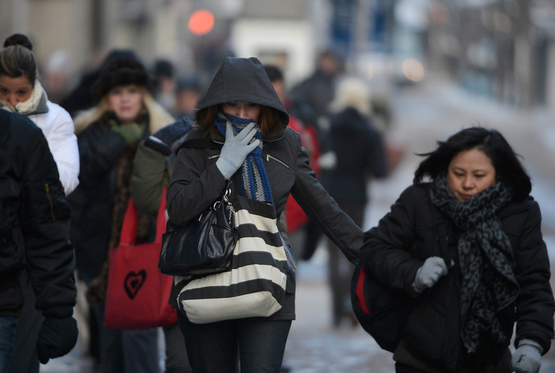 . Pedestrians make their way up the 16th St. Mall in temperatures well below zero Wednesday morning, February 05, 2014. (Photo By Andy Cross / The Denver Post)