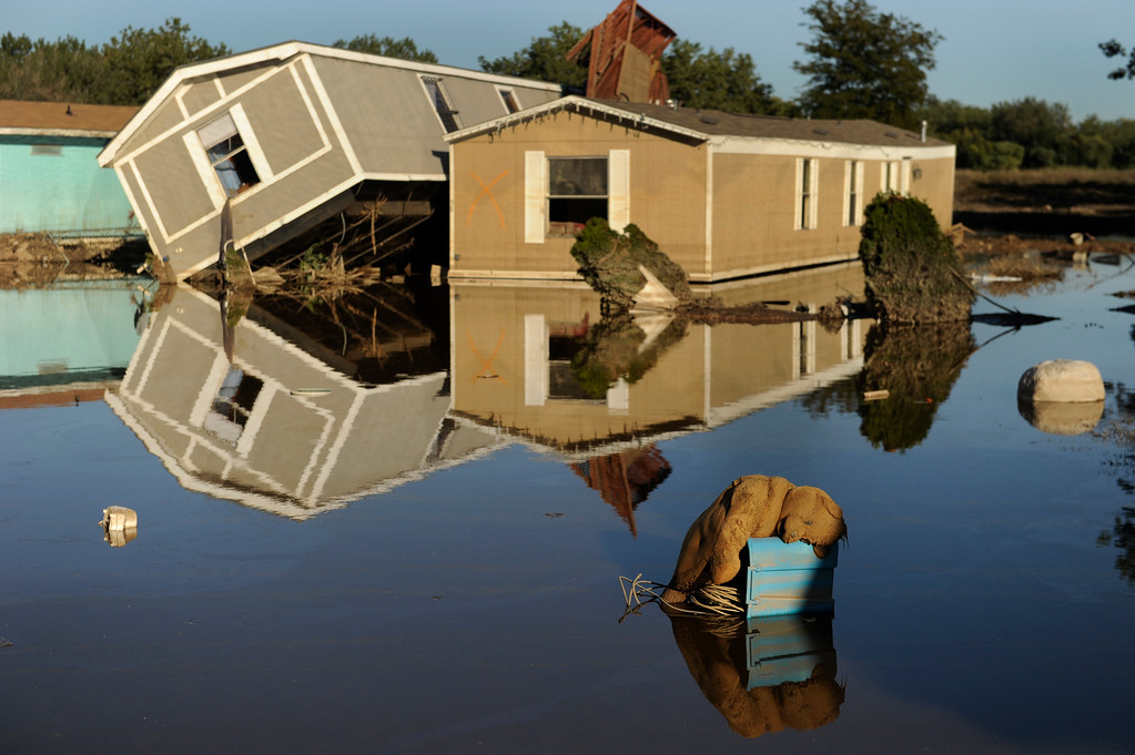 . EVANS, CO. - SEPTEMBER 21: A teddy bear clung to high ground inside the flooded Eastwood Village mobile home park in Evans. Residents of Evans continued the grim work of salvaging personal belongings from flooded homes Saturday afternoon, September 21, 2013. Photo By Karl Gehring/The Denver Post
