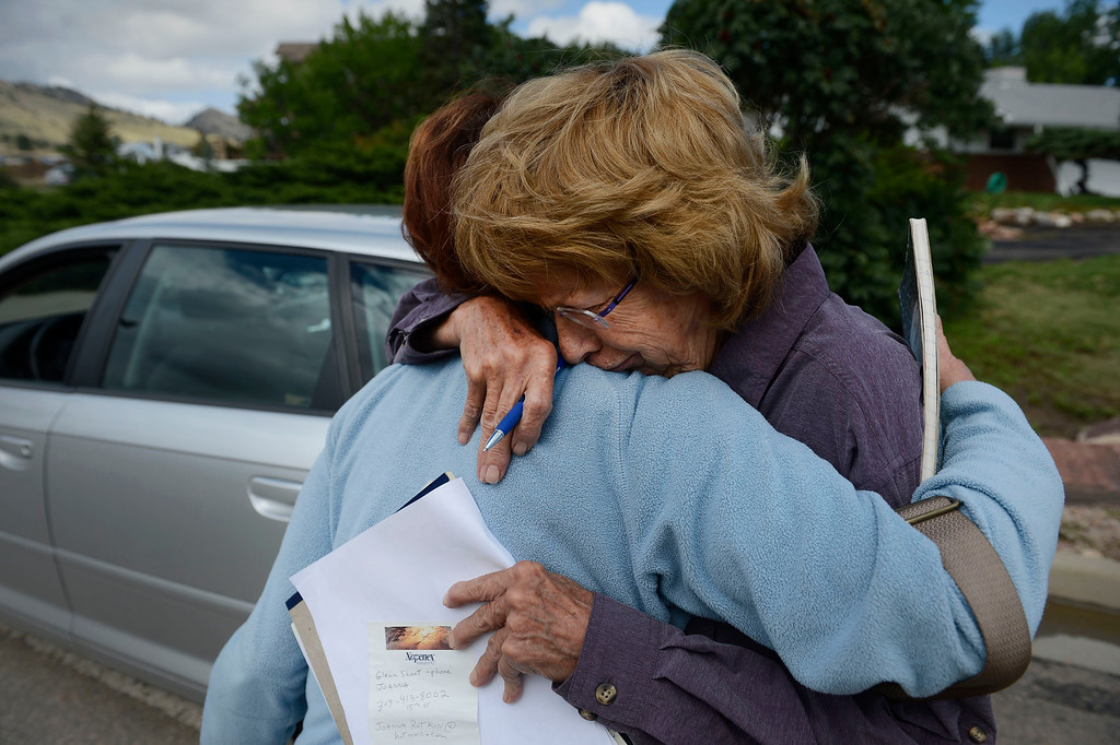 . BOULDER, CO - SEPTEMBER 14: Evacuated Jamestown Colorado residents, Maggie Fitzgerald, left, and Jan Dorsey, right, embrace on September 16, 2013 near the intersection of Lee Hill Drive and 5th St. in Boulder Colorado. Both met with a FEMA official at the intersection to get much needed assistance after their town suffered heavy damage in the flood. (Photo By Andy Cross/The Denver Post)