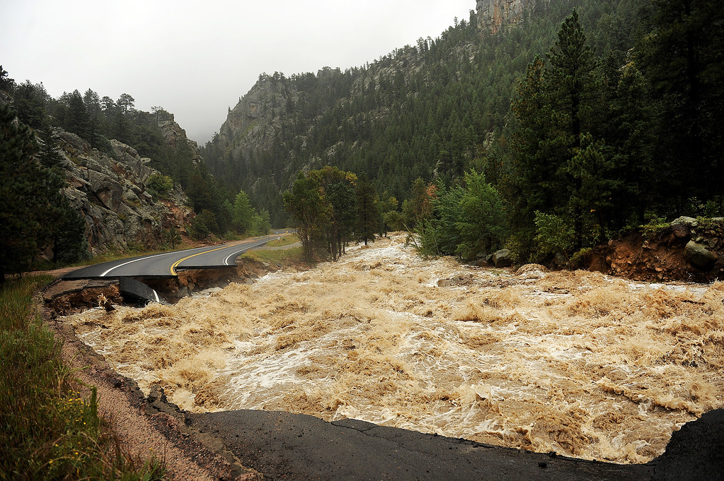 . NEAR LYONS , CO - SEPTEMBER 12: Hwy 7 is completely blown out from the  South St. Vrain river as a torrent of raging water rips through it about 12 miles west of Lyons, Colo. along Highway 7 on September 12, 2013. Heavy and continuous rains have created devastating and major flooding in many mountain communities. Some areas have had over 10 inches of rain in the last 24-48 hours.  (Photo By Helen H. Richardson/ The Denver Post)