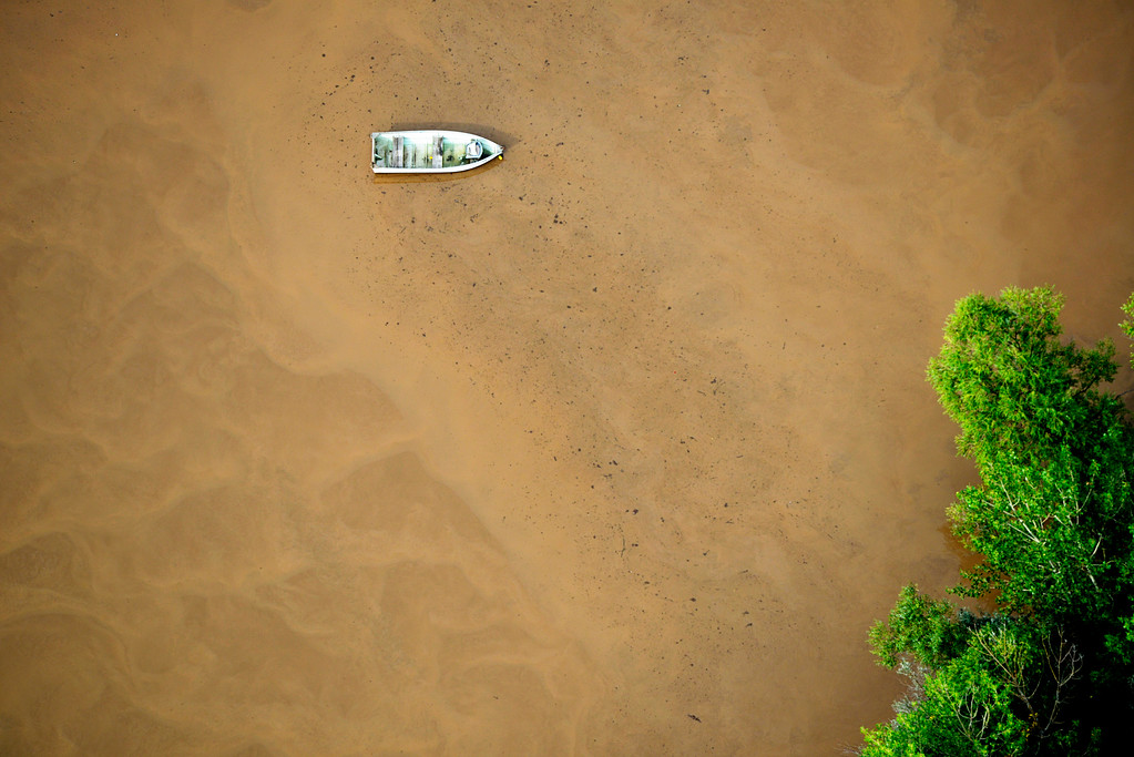 . LOVELAND, CO - SEPTEMBER 14: A fishing boat floats out in a flooded plain in Loveland, Colorado on September 14, 2013. (Photo By Andy Cross/The Denver Post)