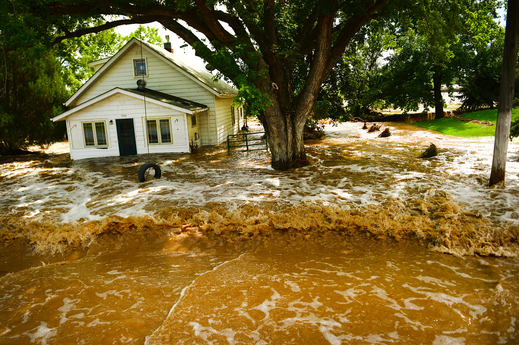 . HYGIENE, CO - SEPTEMBER 13: Flood waters have consumed a house along Hygiene Road east of North 61st street and west of Hygiene, Colo. on September 14, 2013. Massive flooding continues in 14 continues in Colorado.  (Photo By Helen H. Richardson/ The Denver Post)