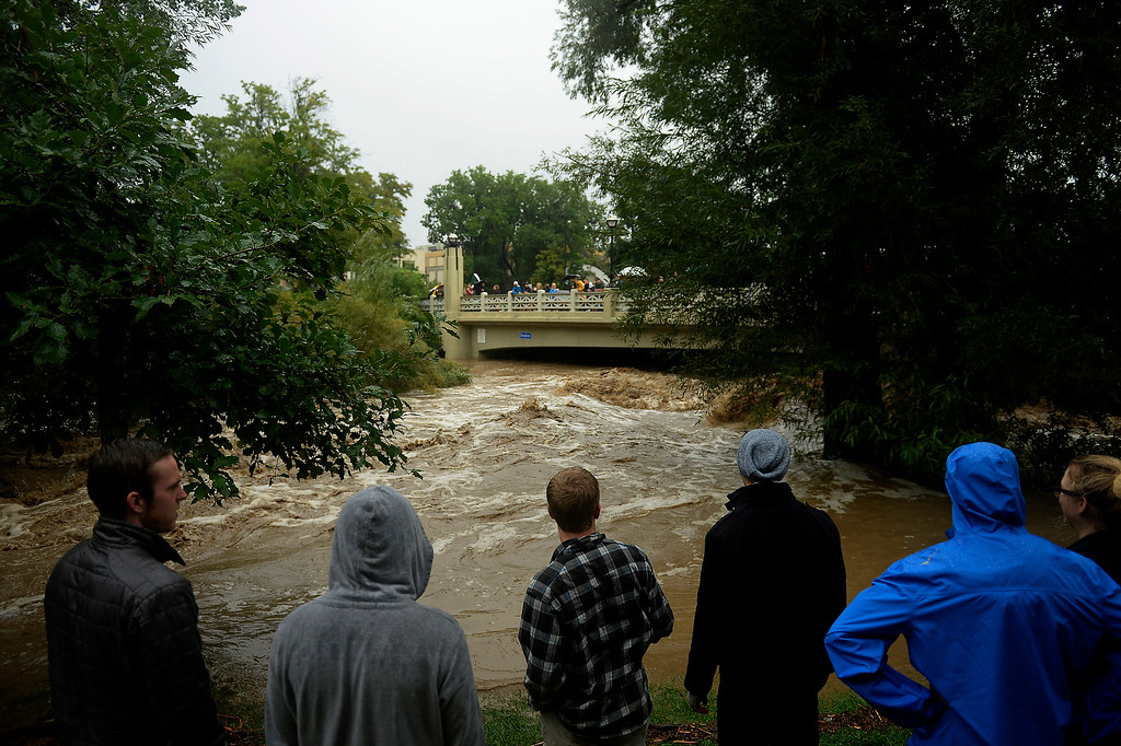 . BOULDER, CO. - September 12: People watch the high water in Boulder Creek after heavy rains caused flash flooding and damage in Boulder, September 12, 2013 in Boulder, Colorado. (Photo By Joe Amon/The Denver Post)