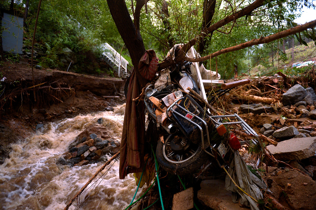 . SALINA, CO. - September 13: A motorcycle is wrapped around a tree in Salina which was mostly washed away after heavy rains caused flash flooding and major damage September 13, 2013. (Photo By Joe Amon/The Denver Post)