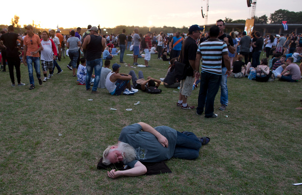 . A Stones fan takes a nap on the grass at the Ciudad Deportiva before the Rolling Stones concert in Havana, Cuba, Friday March 25, 2016. The Stones are performing in a free concert in Havana Friday, becoming the most famous act to play Cuba since its 1959 revolution. (AP Photo/Ramon Espinosa)