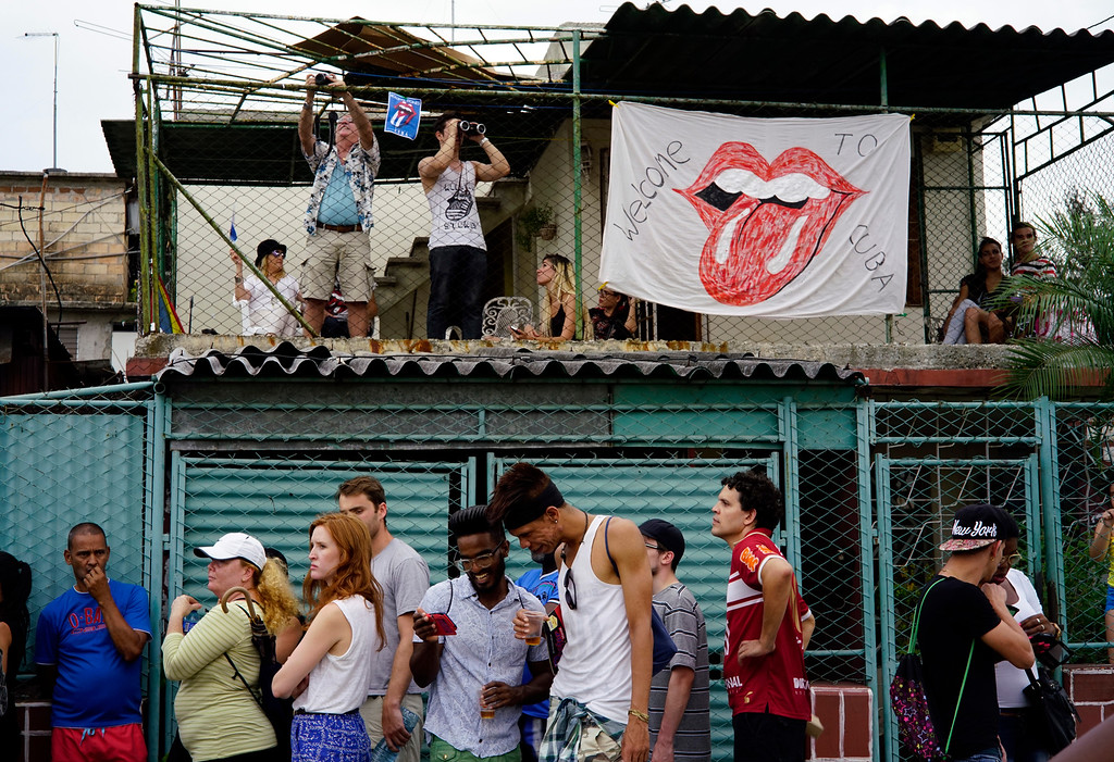 . Fans gather to get a view from a house adjacent to the Ciudad Deportiva before the Rolling Stones concert in Havana, Cuba, Friday March 25, 2016. The Stones are performing in a free concert in Havana Friday, becoming the most famous act to play Cuba since its 1959 revolution. (AP Photo/Ramon Espinosa)
