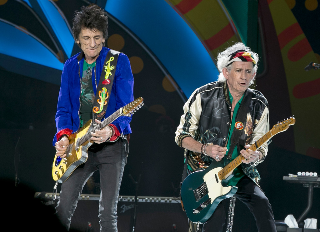 . Keith Richards and Ron Wood play during a Rolling Stones concert in Havana, Cuba, Friday March 25, 2016. The Stones are performing in a free concert in Havana Friday, becoming the most famous act to play Cuba since its 1959 revolution. (AP Photo/Enric Marti)