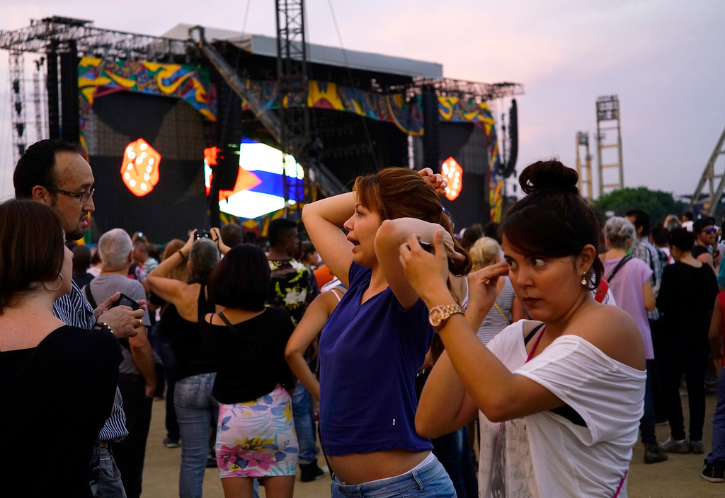 . A girl applies make-up before the Rollig Stones concert at the Ciudad Deportiva in Havana, Cuba, Friday March 25, 2016. v (AP Photo/Ramon Espinosa)