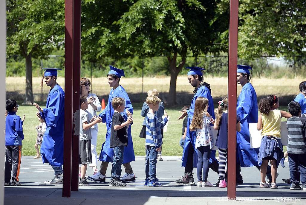 . Members of the WIll C, Wood graduating class of 2018 high-five students at Callison Elementary School during the annual senior parade Thursday at the school.