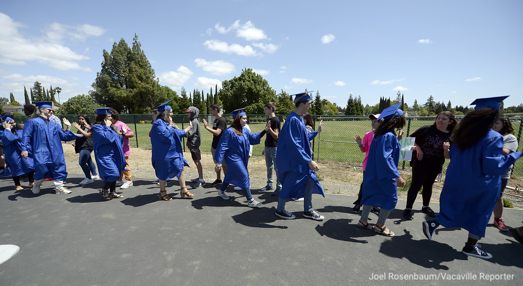 . Members of the WIll C, Wood graduating class of 2018 high-five students at Sierra Vista School during the annual senior parade Thursday at the school.