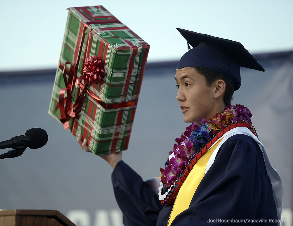 . Using a variety of props, Vacaville Christian High School Valedictorian, Jack Gardner delivers his remarks during graduation ceremonies Thursday at Falcon Field.