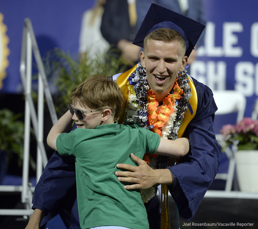 . Vaca Christian High graduate, Adam Grabowski gets a big hug from his cousin, Adam Bieber or Loomis after he received his diploma.