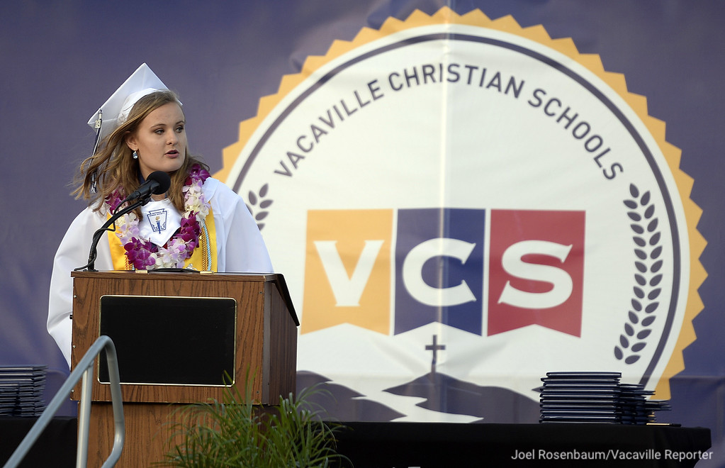 . Vacaville Christian High School Salutatorian, Jessica Jacobs delivers her remarks during graduation ceremonies Thursday at Falcon Field.