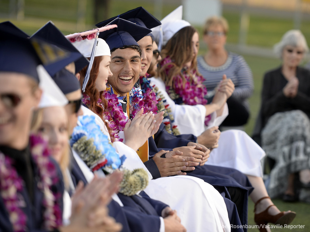 . Vacaville Christian High graduate, Alexander Foley shares a laugh with his fellow classmates during commencement ceremonies on Thursday at Falcon Field.
