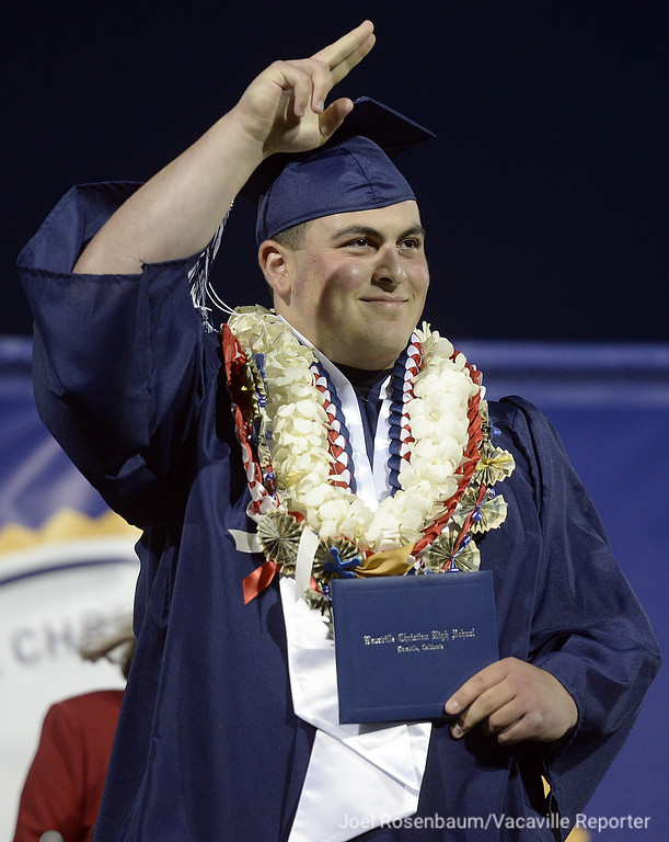 . Vacaville Christian High School graduate Kyle Ishaq reacts to the cheers of his family and friends as he walks across the stage after receiving his diploma during commencement ceremonies Thursday at Vacaville Christian High School.