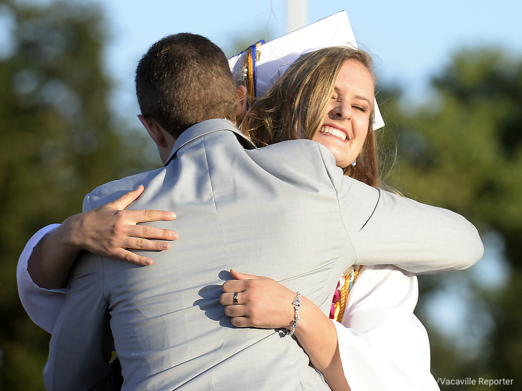. Graduate Jessica Jacobs and class Salutatorian receives a hug from Robert Santos honored her during commencement ceremonies by formally announcing her appointment to the United States Air Force Academy.