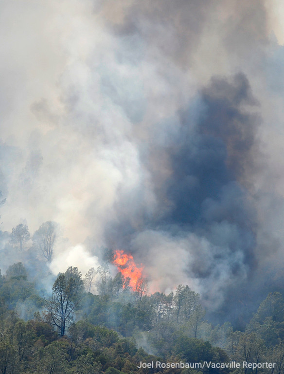 . Flames flare up on a hillside above Guinda, California Monday, July 2, 2018 as the County Fire still rages. According to the California Department of Forestry and Fire Protection (CAL FIRE) the blaze is only five percent contained.