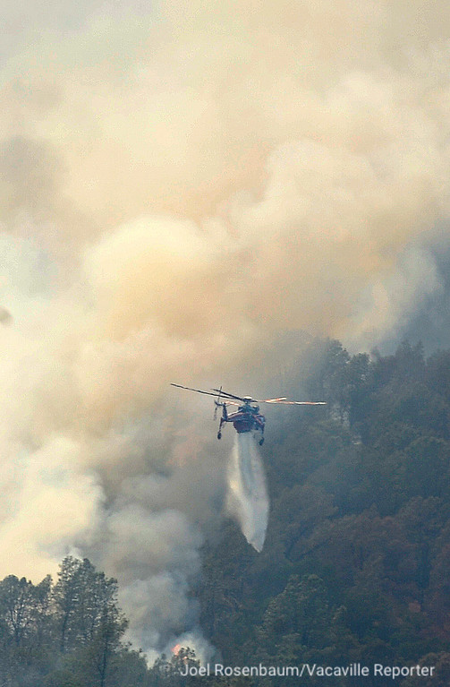 . A Sikorsky Skycrane makes a water drop on a a hillside above Guinda, California Monday, July 2, 2018 as the County Fire still rages. According to the California Department of Forestry and Fire Protection (CAL FIRE) the blaze is only five percent contained.