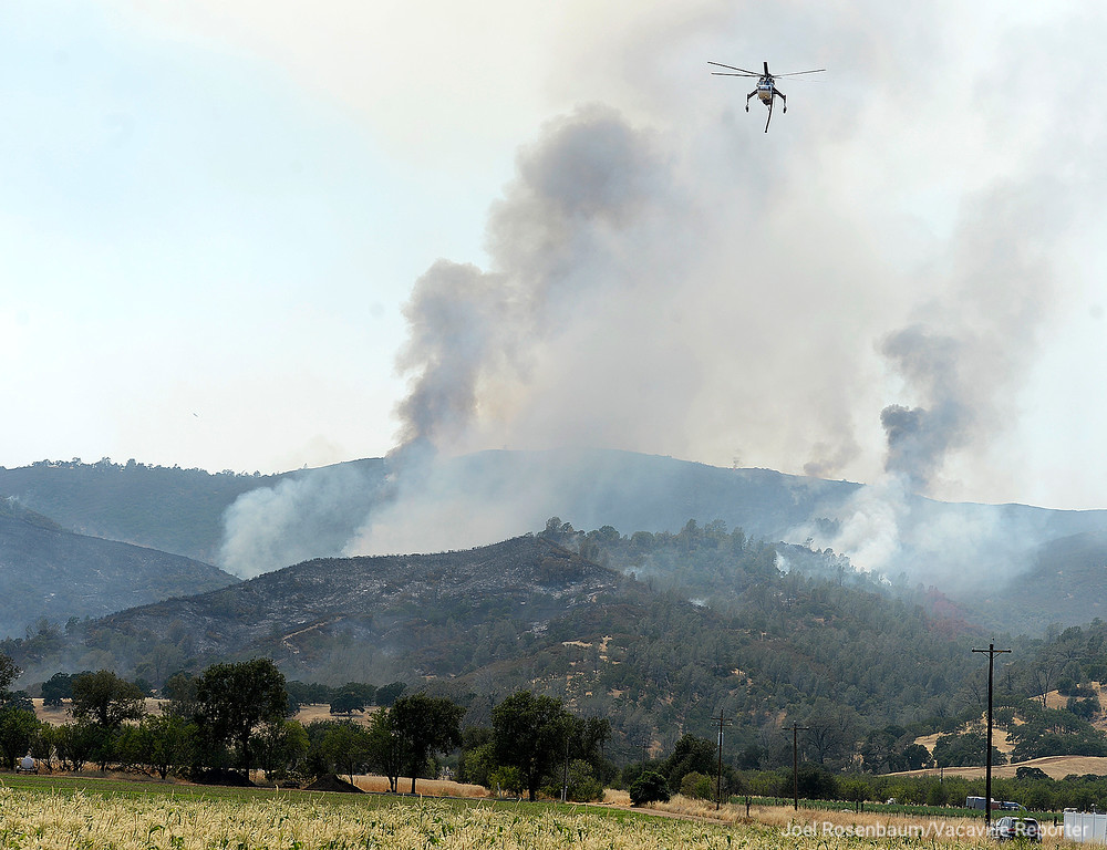 . Smoke billows in to the sky in the hills above Guinda, California Monday, July 2, 2018 as the County Fire still rages. According to the California Department of Forestry and Fire Protection (CAL FIRE) the blaze is only five percent contained.