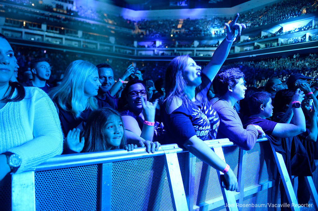 . Foo Fighters fans young and old sing along with the group during their sold-out show at the Golden 1 Center in Sacramento.