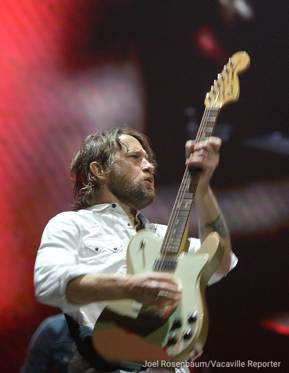 ". Foo Fighters lead guitarist Chris Shiflett plays ""Run\"" during their sold-out show at the Golden 1 Center Saturday in Sacramento."