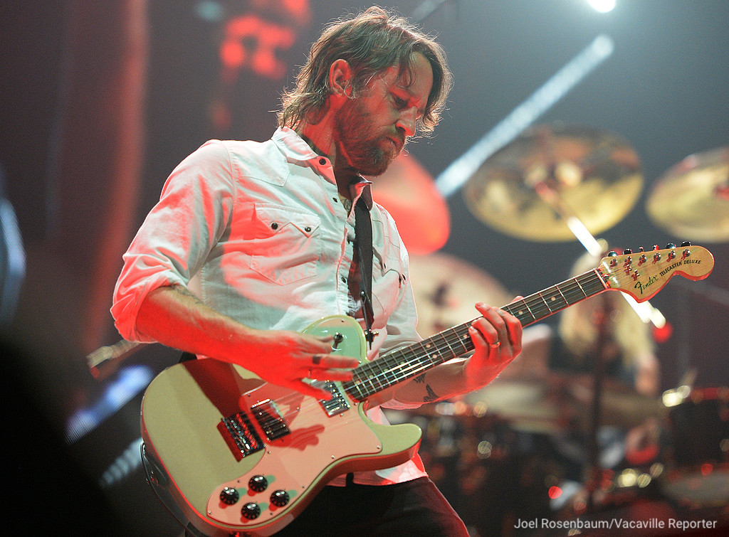 ". Foo Fighters lead guitarist Chris Shiflett plays ""Learning to Fly\"" during their sold-out show at the Golden 1 Center Saturday in Sacramento."