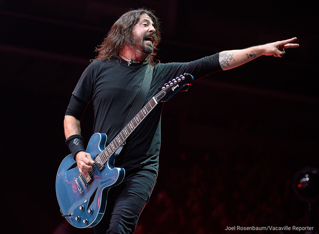 ". Dave Grohl, leads his band, Foo Fighters reacts to the cheers of the crowd after they finished their opening number ""Run\"" Saturday during their sold-out show at the Golden 1 Center in Sacramento."