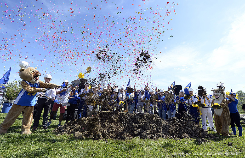 . With confetti flying into the air, Will C. Wood students turn over the first shovels of dirt to be moved at the new stadium complex that will be built on campus during a groundbreaking ceremony Thursday at the school.