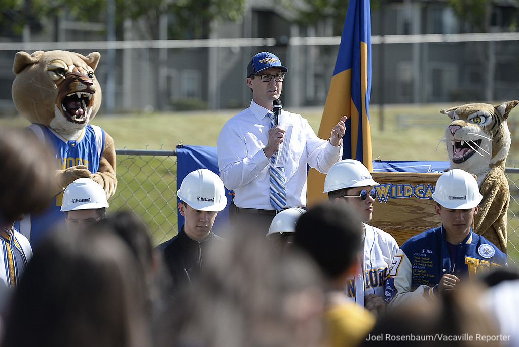. Flanked by Wildcat mascots, WIll C. Wood High School principal, Adam addresses students, faculty, staff and goverment officals gathered Thursday during a groundbreaking ceremony for the news stadium complex.