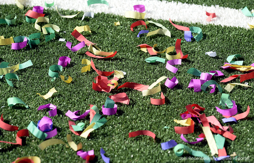 . Confetti used in the grand opening ceremony for the new Wildcat Stadium litters the field.