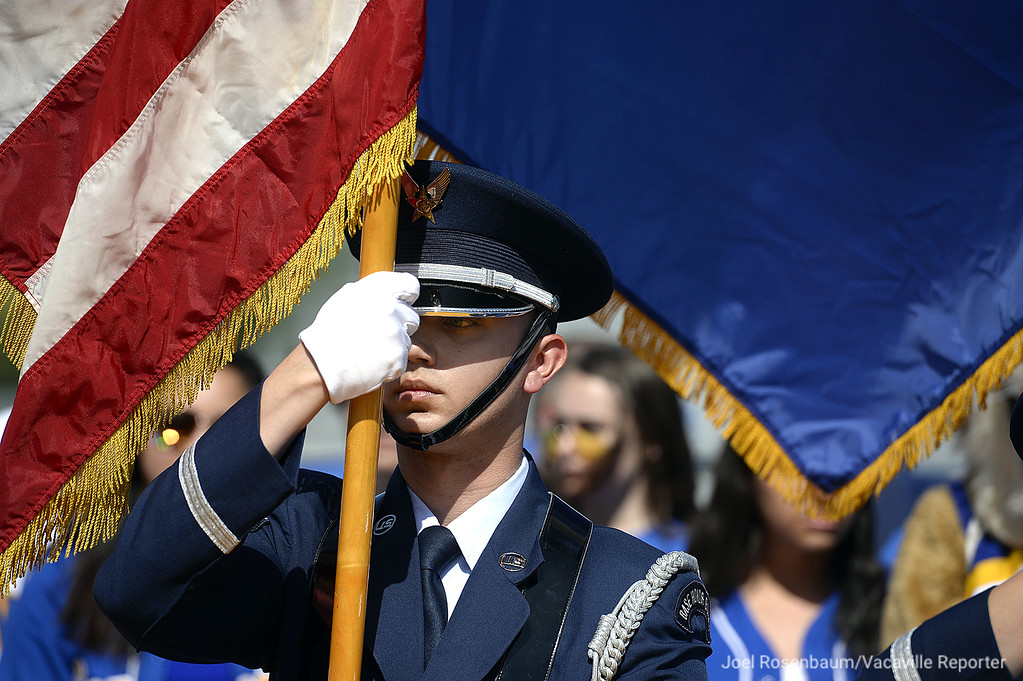. A member of the Travis Air Force Base Honor Guard stands at attention as the national anthem is sung by the Will C. Wood High School Choir.