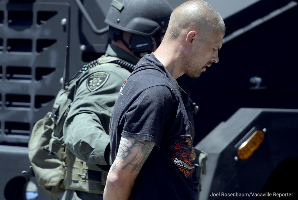 . A member of the Solano County Sheriff\'s SWAT team detains one of two suspects that were removed from an apartment in the 800 block of Delaware Street in Fairfield after one of them barricaded himself inside the apartment following a short pursuit Monday in a stolen car with Sheriff\'s deputies.