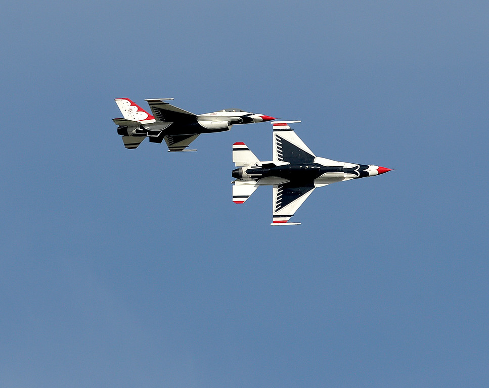 ". Thunderbird 8 (left) and Thunderbird 7 soar over the skies of Travis Air Force Base after returning from a incentive flight for Captain Chesley ""Sully\"" Sullenberger. Joel Rosenbaum -- The Reporter"
