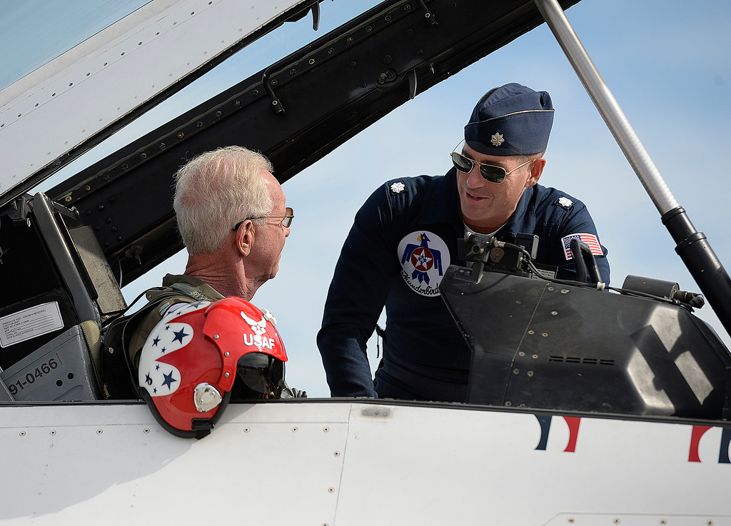 ". Captain Chesley ""Sully\"" Sullenberger  gets some last minute instructions from pilot, Lt. Col. Kevin Walsh, Thunderbirds Operations Officer before taking his flight with the United States Air Force\'s Demonstration Squadron, the Thunderbirds, Thursday at Travis Air Force Base. Joel Rosenbaum -- The Reporter"