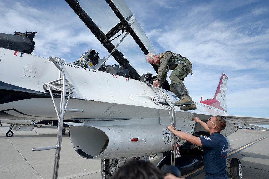 ". Captain Chesley ""Sully\"" Sullenberger climbs into the rear seat  of Thunderbird 7 before taking his flight with the United States Air Force\'s Demonstration Squadron, the Thunderbirds, Thursday at Travis Air Force Base. Joel Rosenbaum -- The Reporter"