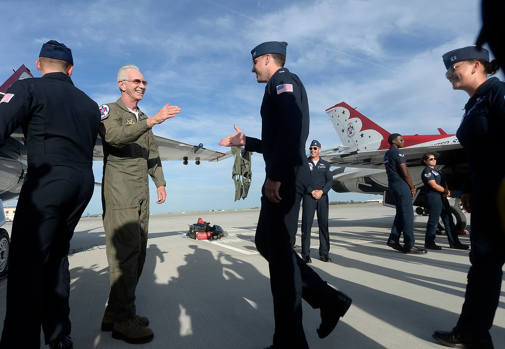". Captain Chesley ""Sully\"" Sullenberger greets all the members of the United States Air Force Thunderbirds after he flew with them Thursday at Travis Air Force Base. Joel Rosenbaum -- The Reporter"