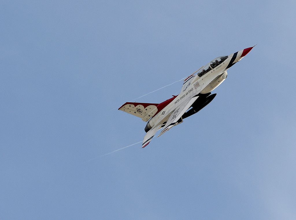 ". Thunderbird 7 piloted by Lt. Col Kevin Walsh soars over the skies of Travis Air Force Base after returning from a incentive flight for Captain Chesley ""Sully\"" Sullenberger. Joel Rosenbaum -- The Reporter"