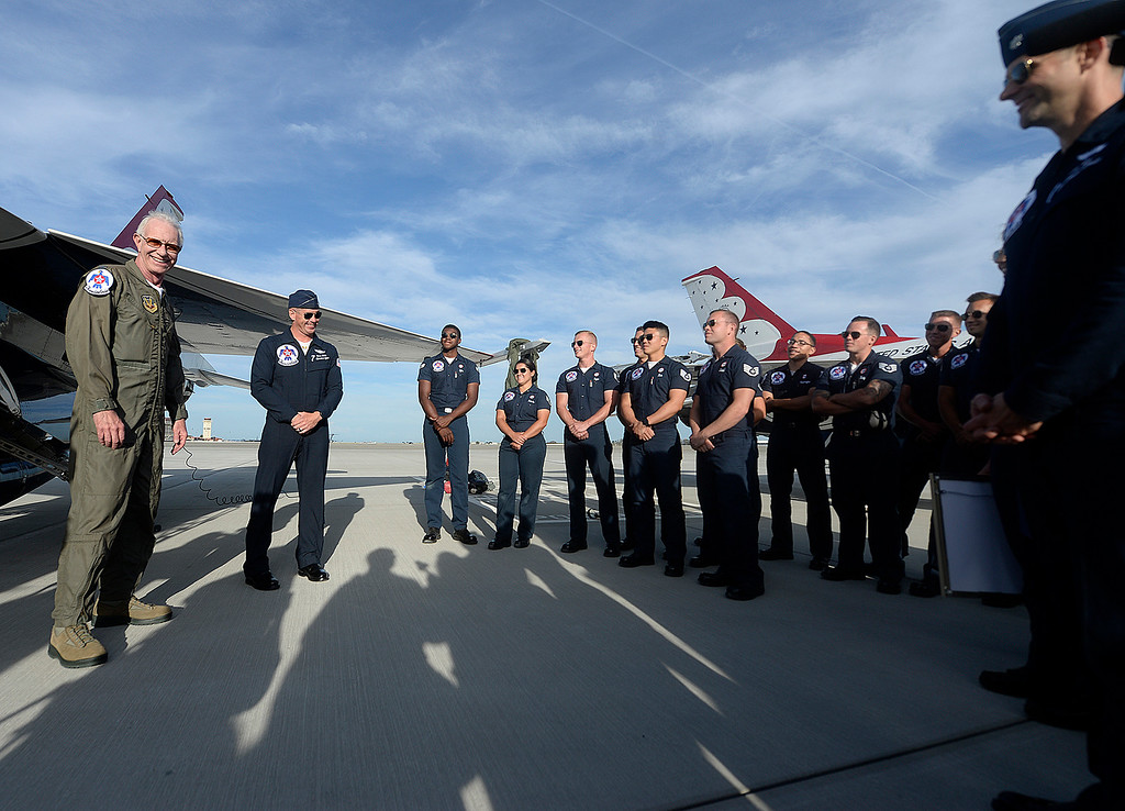 ". Captain Chesley ""Sully\"" Sullenberger talks with members of the United States Air Force Thunderbirds after he flew with them Thursday at Travis Air Force Base. Joel Rosenbaum -- The Reporter"