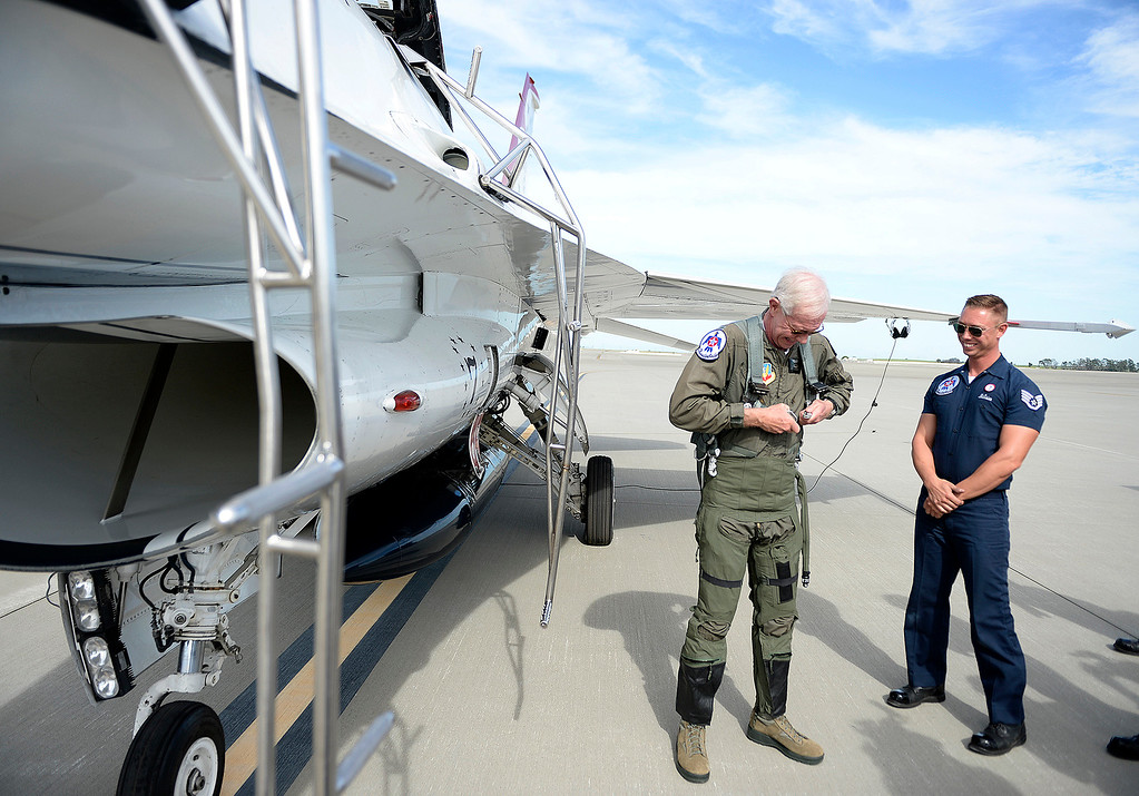 ". Captain Chesley ""Sully\"" Sullenberger puts on his g-suit before taking his flight with the United States Air Force\'s Demonstration Squadron, the Thunderbirds, Thursday at Travis Air Force Base. Joel Rosenbaum -- The Reporter"