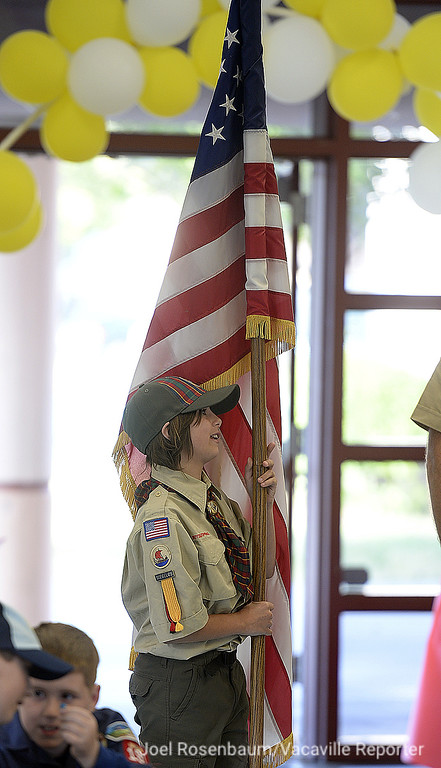 . Brenna Perry, 10 of Vacaville prepares to carry the American flag during the opening flag ceremony at the monthly pack meeting at Foxboro Elementary School. Perry is one of eight girls who are a member of the pack, which is part of scoutings early adopter  program that allows girls to join.
