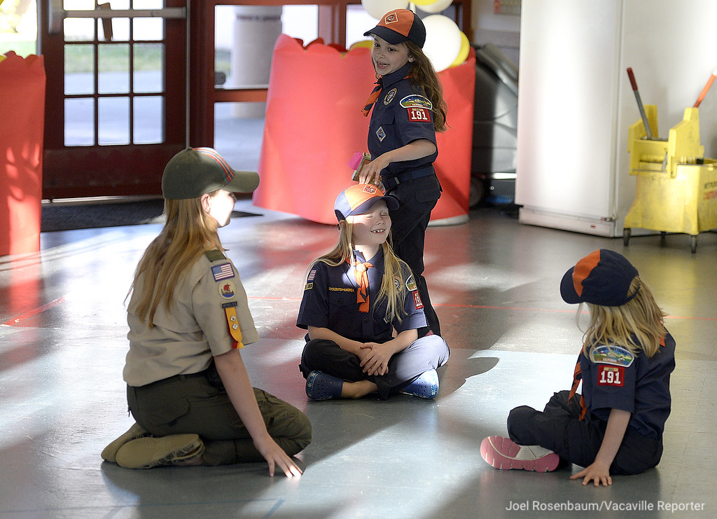 . Teagan Byrd, 7 taps Emma Thomsen, 6 on the head as she plays a game of duck, duck, goose with her fellow cub scouts. Lara Thomsen,10 (left) and Sierra Washington 7 before recent den meeting for the girls who are all members of Vacaville Cub Scout Pack 191.