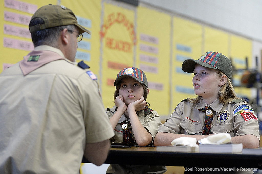 . Brenna Perry, 10 (left) and Lara Thomsen, 10 work with their den leader, Ron Byrd as they learn about knife safety at a recent meeting. Both girls are Webelos, the final rank in Cub Scouts before advancement to Boy Scouts. Both girls are working on rank and will be eligible to join a scout troop in 2019.