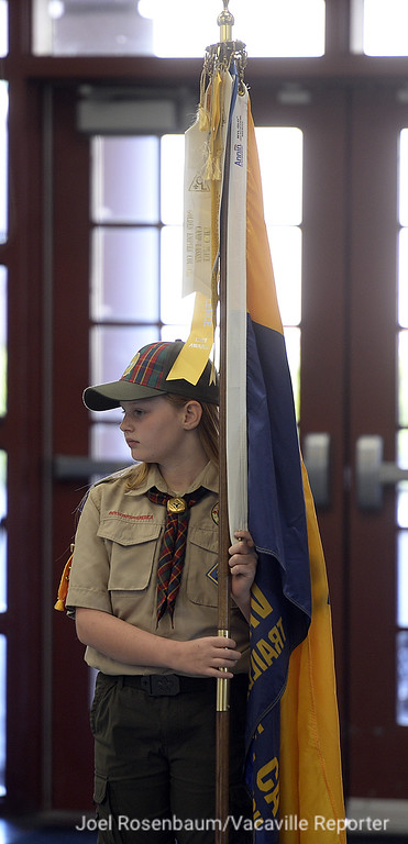 . Lara Thomsen, 10 of Vacaville prepares to carry the flag of Cub Scout Pack 191 during the opening flag ceremony at the monthly pack meeting at Foxboro Elementary School. Thomsen is one of eight girls who are a member of the pack, which is part of scoutings early adopter  program that allows girls to join.